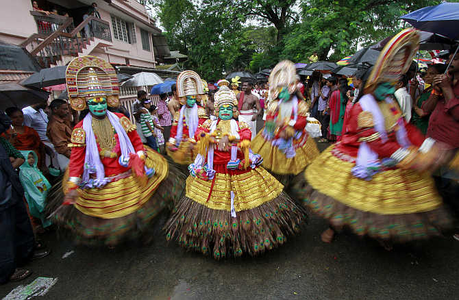 Dancers perform as they take part in festivities marking the start of the annual harvest festival of Onam in Kochi.