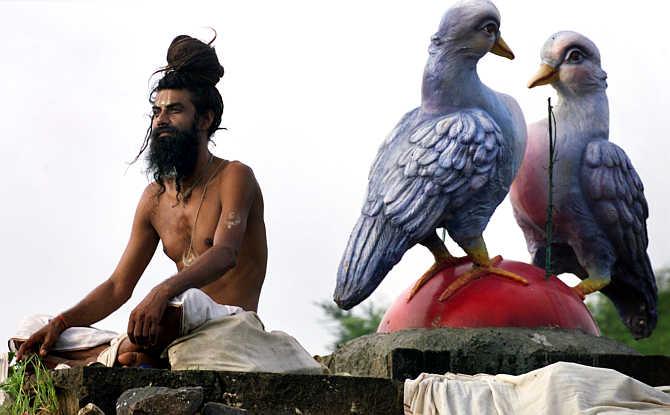 A Devotee attends the Kumbh Mela on the banks of the Godavari river in Nasik.