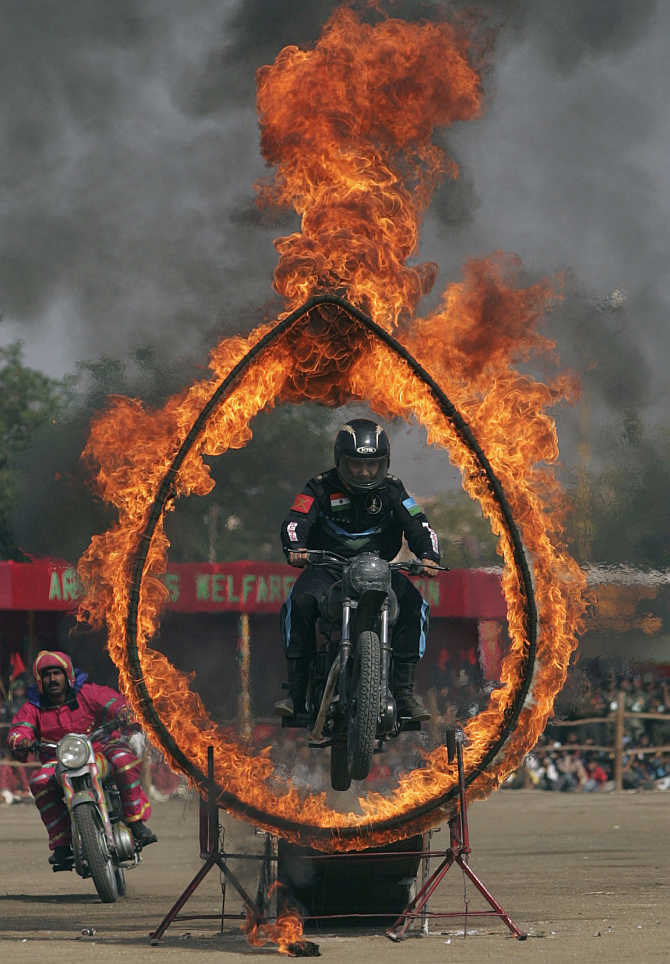 A soldier performs a motorcycle stunt in Rajkot.