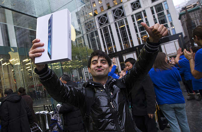 Rami Shamis celebrates outside the Apple Store on New York's Fifth Avenue after buying an iPad Air.