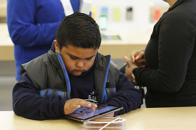 A child uses an iPad Air tablet at the Apple store in San Francisco, California.