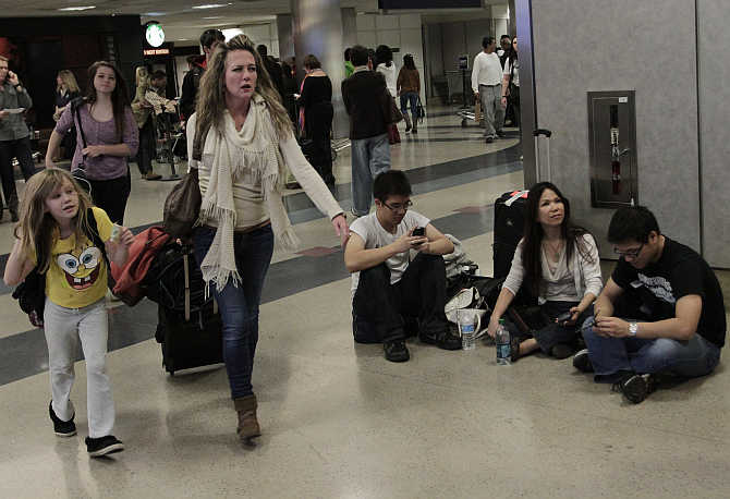 Travellers at the Delta Airlines arrival area at Los Angeles International Airport in Los Angeles, California.