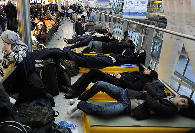 Passengers sleep on makeshift beds in Terminal 5 at Heathrow Airport in west London.