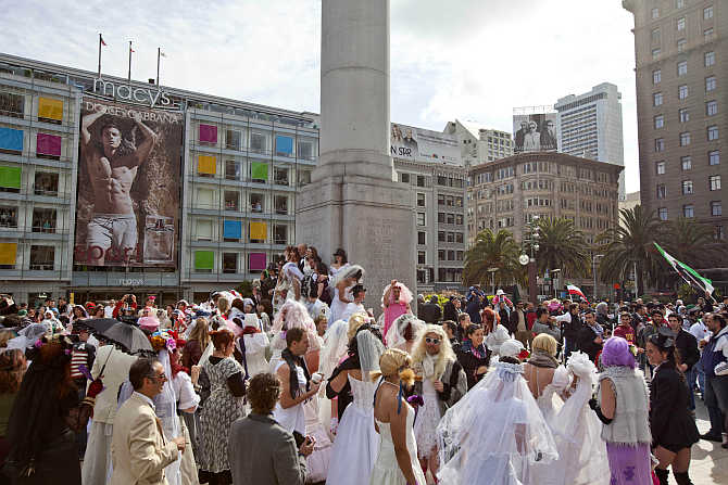 Participants, dressed in bridal outfits, gather in Union Square during the March of Brides parade through downtown San Francisco.