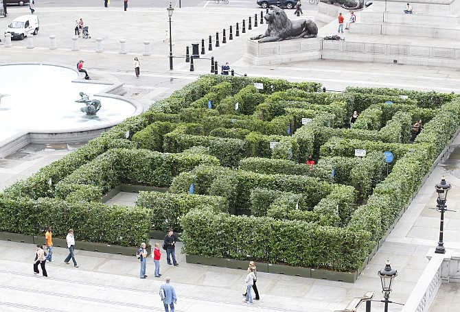 Visitors walk past a maze which has been set up in Trafalgar Square to promote London's West End shopping and entertainment district.
