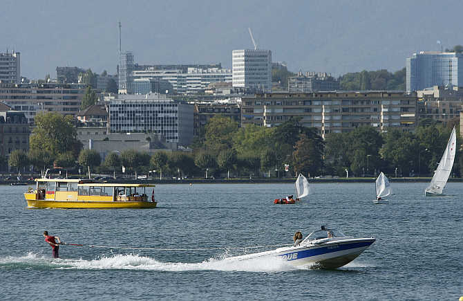 A wakeboarder performs on Lake Leman on a hot autumn day in Geneva.