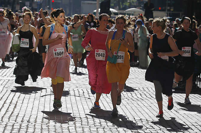 Participants leave the starting line at the annual Running with The Bridesmaids event in Boston, Massachusetts.