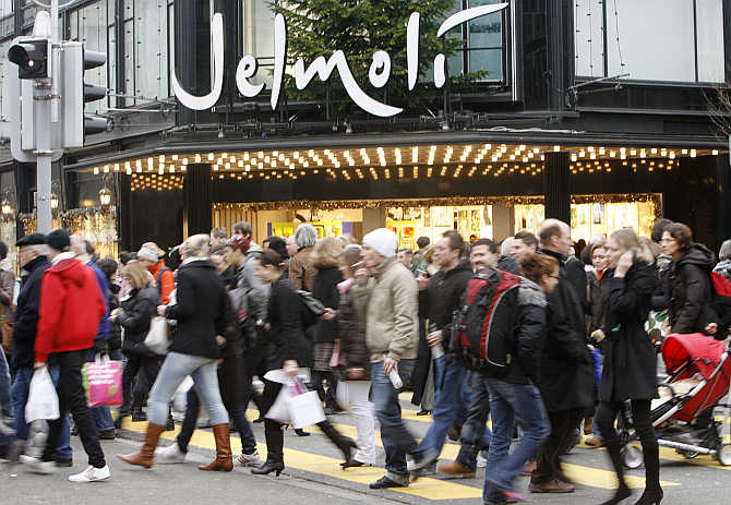 People walk past the Jelmoli department store on Zurich's main shopping street Bahnhofstrasse.