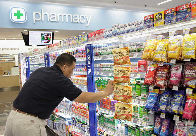 A worker stocks a Walgreens store in Chicago.