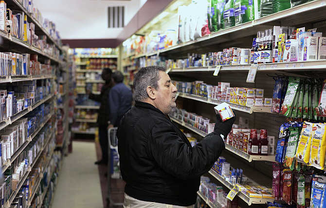 A customer takes a look at medication on a shelf at a pharmacy in New York.