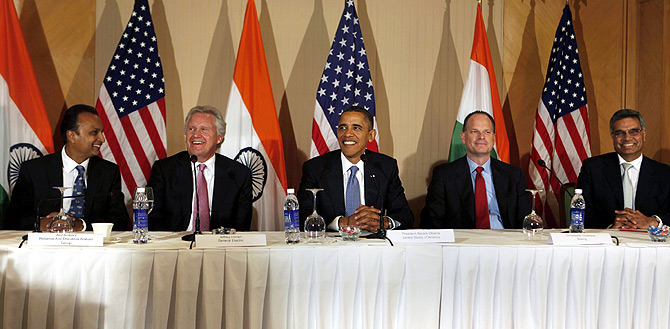(L-R) Reliance Anil Dhirubhai Ambani Group Chairman Anil Ambani, General Electric Co. Chairman Jeffrey Immelt, U.S. President Barack Obama, Boeing Military Aircraft President Chris Chadwick and Spicejet Airways Promoter-Director Bhupendra Kansagra smile during Obama's meeting with entrepreneurs in Mumbai.
