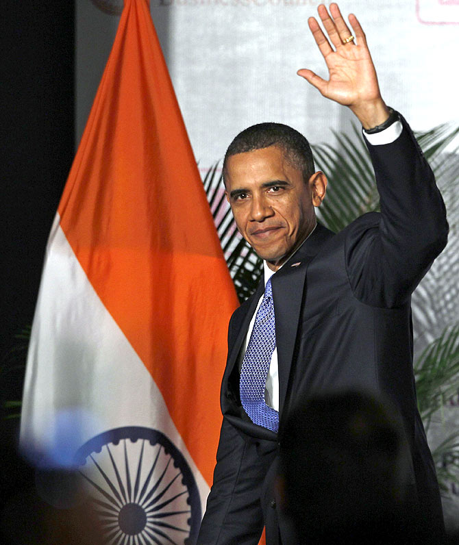 U.S. President Barack Obama waves after delivering remarks at the U.S.-India Business and Entrepreneurship Summit in Mumbai.
