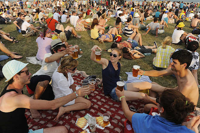 Revellers drink beer during the Pohoda music festival at Trencin airport, 130km north of Bratislava, Slovakia.