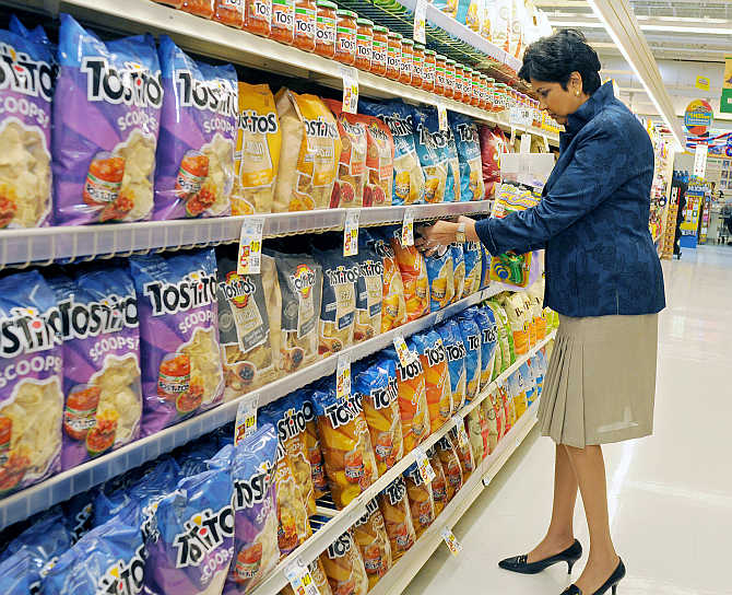 PepsiCo CEO Indra Nooyi checks products at the Tops SuperMarket in Batavia, New York.