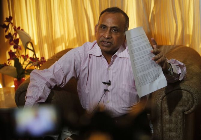Uttam Khobragade, father of Devyani Khobragade, India's deputy consul general in New York, speaks during a news conference in Mumbai.