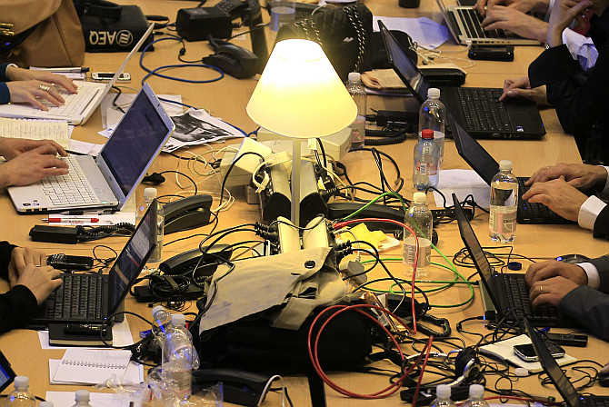 Journalists work in the main media hall at the European Union summit in Brussels, Belgium.