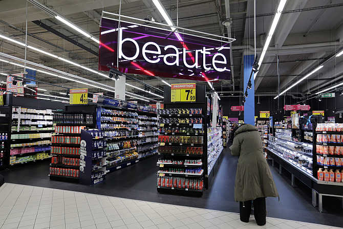 A customer stands in front the Beauty department at Carrefour's Bercy hypermarket in Charenton, a Paris suburb.