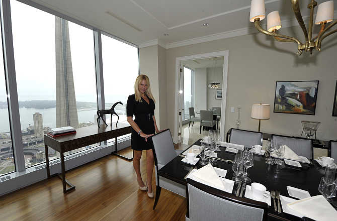 Sales Manager Jacqueline Yaffe in the dining room of a model suite in a hotel in Toronto. Photo is for representation purpose only.