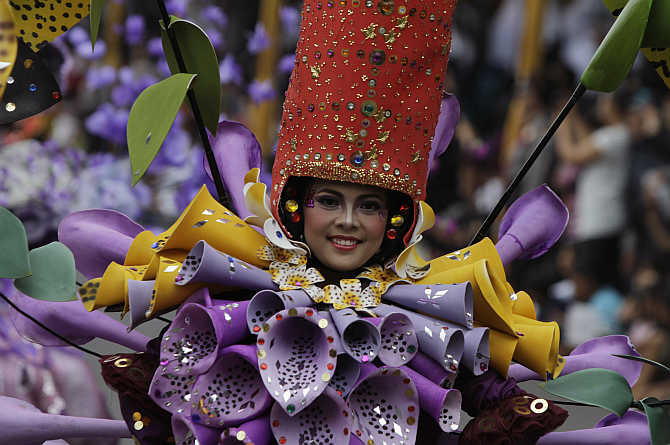 A woman dressed in flower costumes participate in the11th Jember Fashion Carnival in Jember, Indonesia's East Java province. The community also flourished in Java.