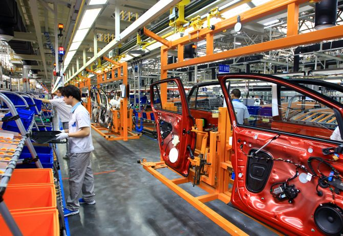 Employees work on the production line of new Golf sedan at a plant of FAW-Volkswagen Automotive Company.