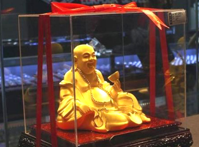 A gold Buddha statuette is seen inside a Luk Fook Jewellery shop in Yichang, Hubei province, May 20, 2012.