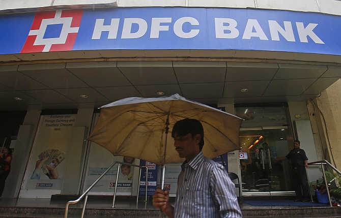 A customer walks outside an HDFC Bank branch in Mumbai.