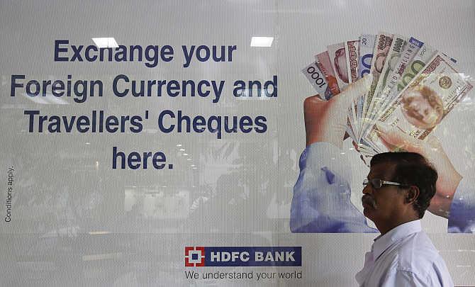 A customer walks outside an HDFC Bank branch in Mumbai.