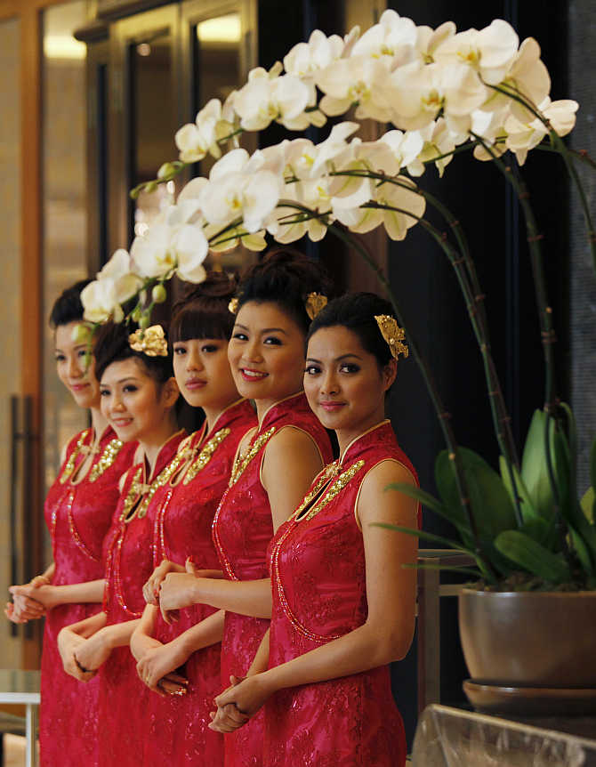 Attendants welcome guests inside Galaxy Macau, a resort in Macau.