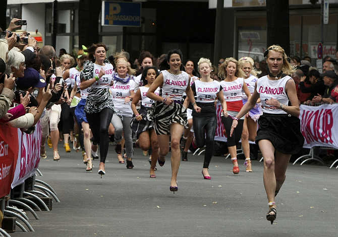 Women compete in a 100-metre stiletto sprint competition in Berlin, Germany.