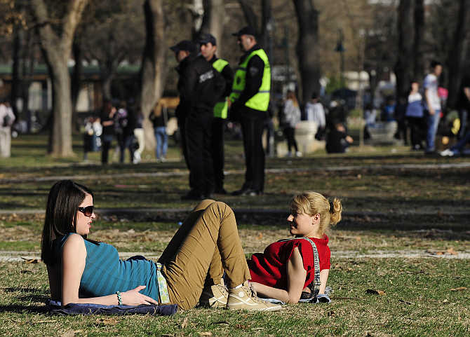 People enjoy warm weather in Skopje's city park, Macedonia.
