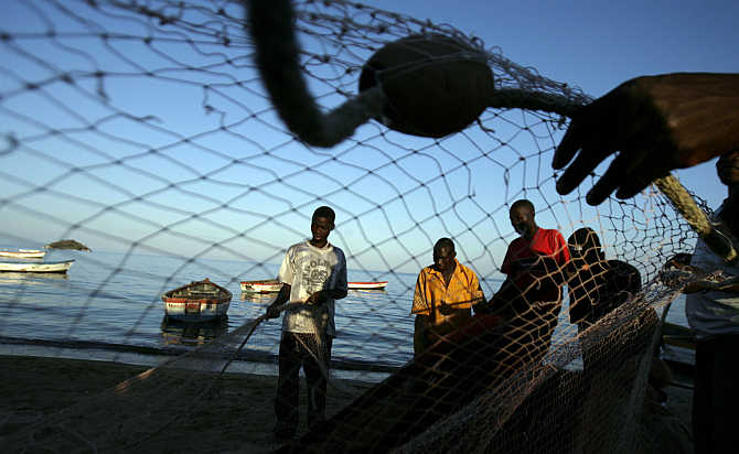 Fishermen prepare their nets on the banks of Lake Malawi about 100km east of the capital Lilongwe, Malawi.