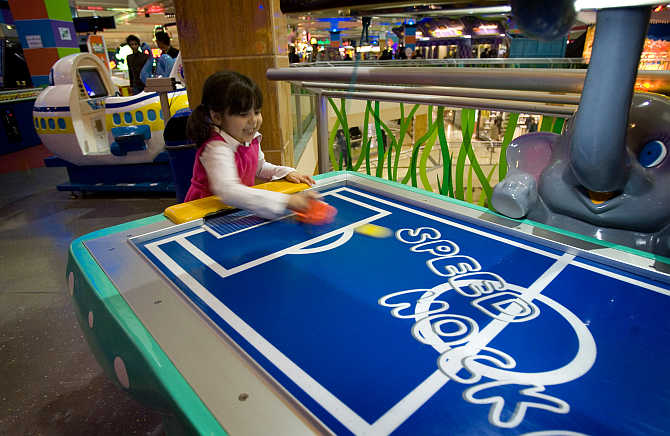 A girl plays a game at the Wonderland fun centre in north western Tehran, Iran.