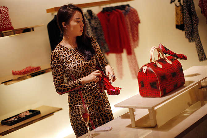 A woman shops in a Louis Vuitton store in downtown Shanghai, China.