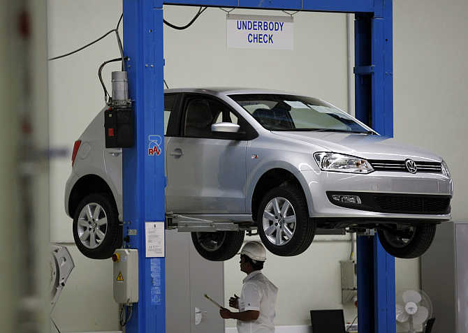 An employee inspects Polo at the assembly line at the Volkswagen's plant in Chakan, about 180km south of Mumbai.