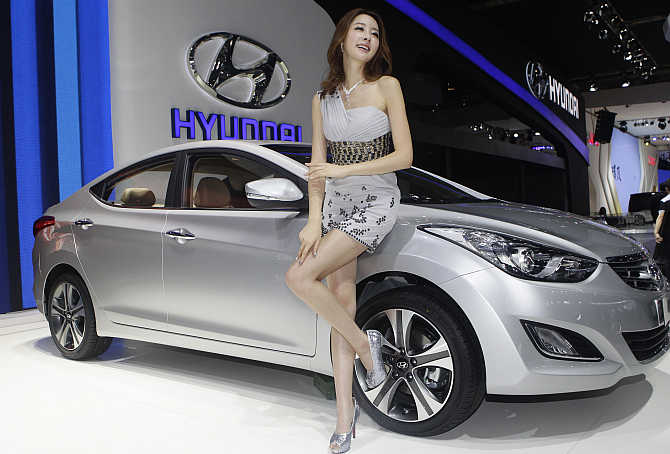 A model stands next to a Hyundai Elantra in Beijing.