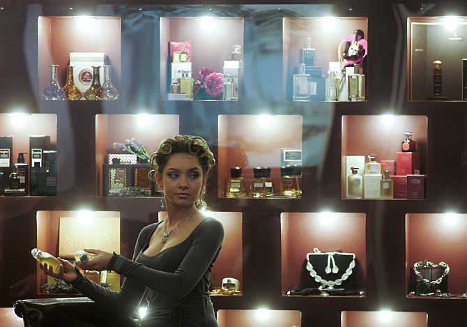 A woman presents perfume at the Millionaire Fair in Moscow, Russia.