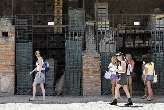 Visitors walk in Pompeii, the famous city next to Naples which was destroyed in AD 79 by the eruption of Mount Vesuvius, Italy.