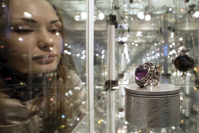 A visitor looks at an item on display at the annual St Petersburg's Jeweller International Exhibition in Russia.