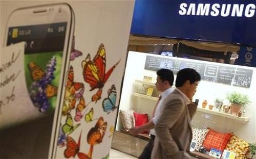 People walk at a Samsung Electronics store.