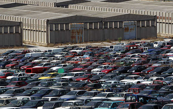 Confiscated cars inside a warehouse of Oddy in Athens.