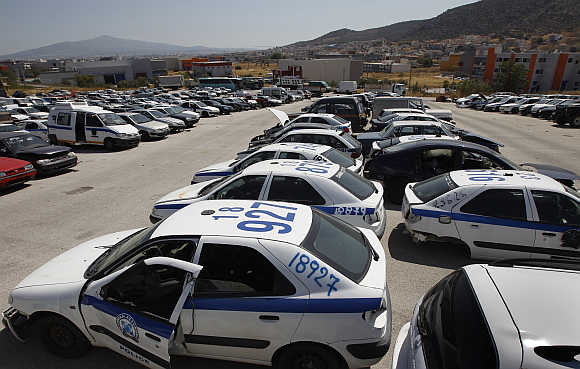 Wrecked police vehicles in a yard of Oddy in Athens.