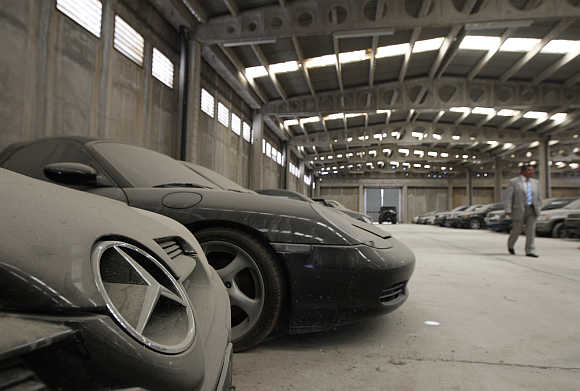 Confiscated luxury cars inside a warehouse of Oddy in Athens.