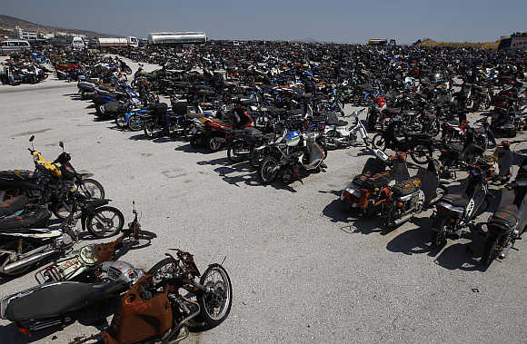 Damaged and confiscated motorcycles in a yard of Oddy in Athens.