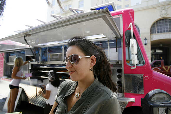 Michelle Madrid waits for her burger in Hollywood, California.