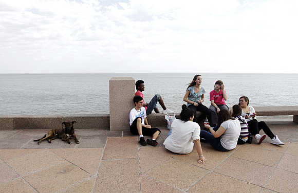 Residents enjoy the weather on an unseasonably hot day at the Montevideo's waterfront.