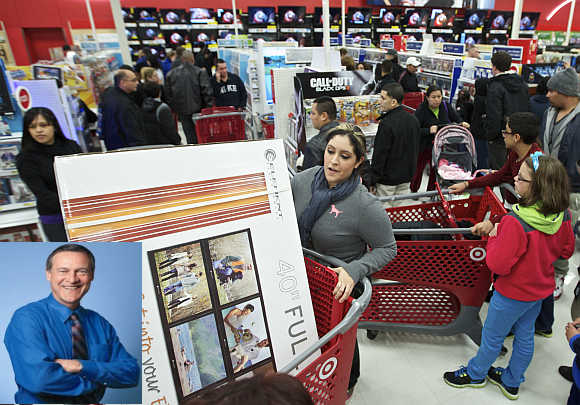 Shoppers pack a Target store in Chicago. Robert Ulrich, inset.