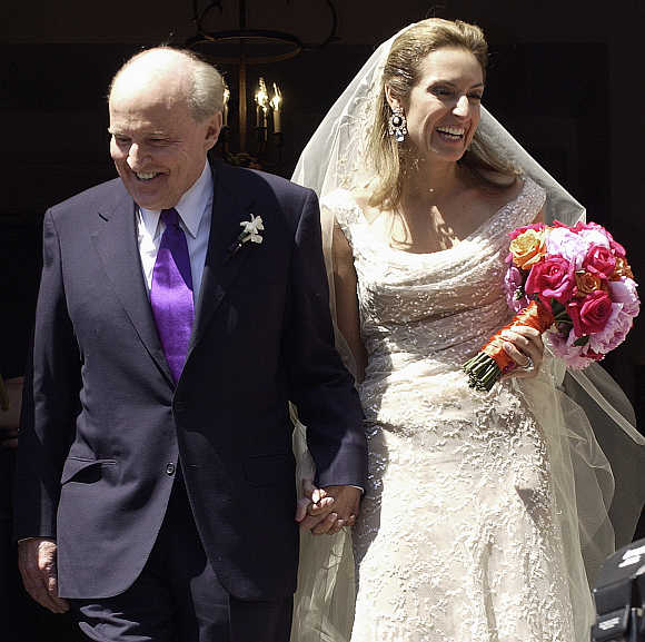 Former CEO of General Electric Jack Welch walks down the steps of Park Street Church with Suzy Wetlaufer after their wedding in Boston, Massachusetts.