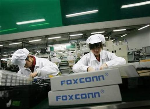 Employees work inside a Foxconn factory.