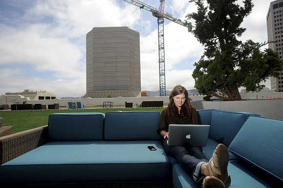 Jenna Sampson, a community relations manager at Twitter, works on the company's rooftop deck in San Francisco, California, United States.