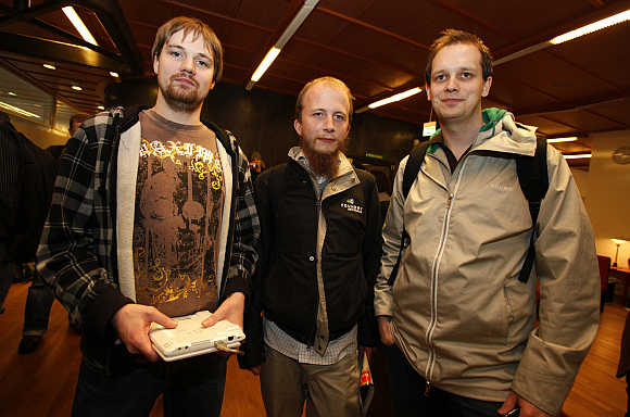 Pirate Bay co-founders Fredrik Neij, left, Gottfrid Svartholm, centre, and Peter Sunde, right, in Stockholm, Sweden.